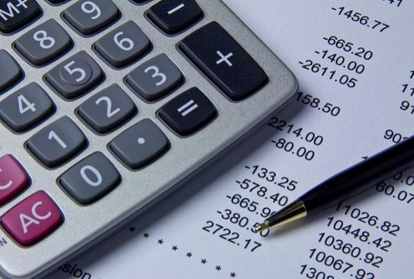 Photo of a calculator on a balance sheet