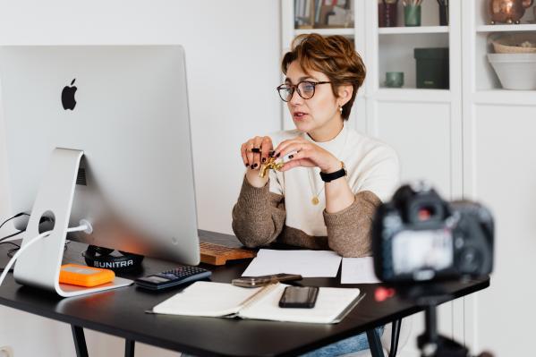 Woman tutoring via webcam