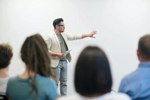 man teaching a group